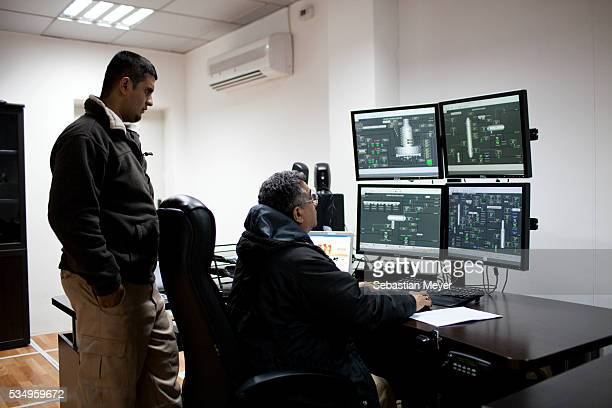 Two workers monitor the Kar Refinery from the Control Room in Erbil Iraq An oil boom is underway in the autonomous northern region of Iraqi Kurdistan...