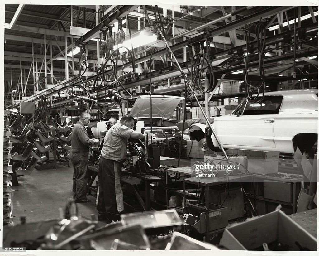 Two Workers On The Ford Thunderbird And Lincoln Continental Assembly Line At Motor Company