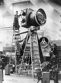 Two workers set up a giant model erneman camera for the opening of picture id2642652?s=170x170