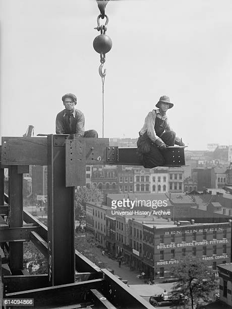 Two Workers Sitting on Steel Beams during Building Construction USA circa 1929