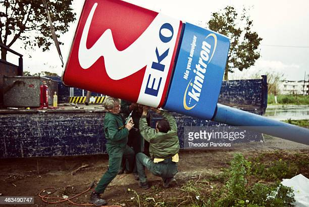 CONTENT] Two workers they try to restore a sign of EKO gas in Kardamaina Kos Island Greece on February of 2013