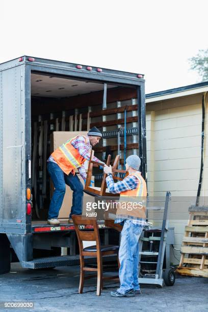 Two workers with a truck, moving furniture
