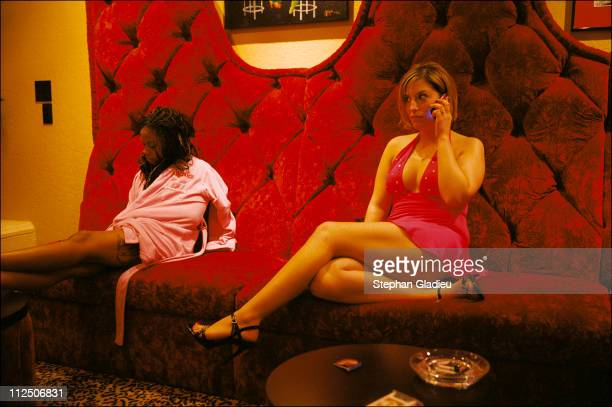 Two working girls killing time while waiting for customers in the parlor of the Moonlite Bunny Ranch, a legal brothel owned by Dennis Hof, in Lyon...