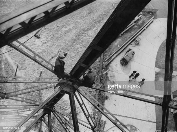 Two workmen begin to dismantle the airship mooring masts which formerly tethered the R101 airship to reclaim the steel and iron as part of the...