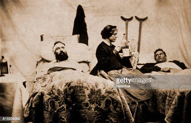 Two wounded Federal soldiers are cared for by Anne Bell a nurse during the American Civil War