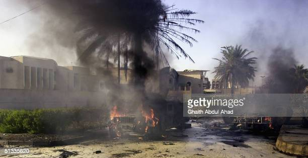 Two wrecked humvees belonging to the 1st Marine Expeditionary Force are seen September 22 2004 in the Mansour district of Baghdad Iraq An explosion...