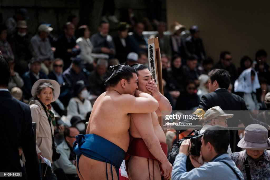 Two wrestlers talk each other during 'Honozumo' ceremonial on April 16, 2018 in Tokyo, Japan. This annual offering of a Sumo Tournament to the divine at the Yasukuni Shrine has taken place since 1869.