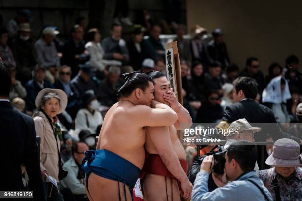 Two wrestlers talk each other during 'Honozumo' ceremonial on April 16, 2018 in Tokyo, Japan. This annual offering of a Sumo Tournament to the divine...