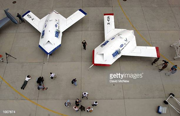 Two X45A Unmanned Combat Air Vehicles are shown to members of the news media July 11 2002 at Edwards Air Force Base California The X45A developed by...