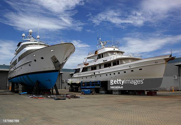 Two yachts on shipyard