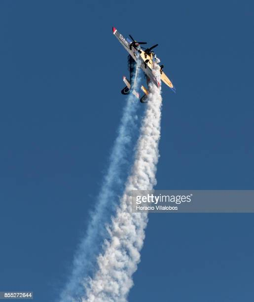 Two Yakovlev Yak-52 perform aerobatics over Tagus River during the commemoration of the 100th anniversary of Portuguese Naval Aviation on September...