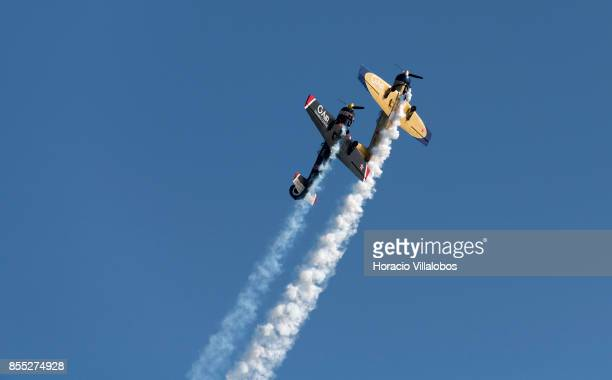 Two Yakovlev Yak52 perform aerobatics over Tagus River during the commemoration of the 100th anniversary of Portuguese Naval Aviation on September 28...