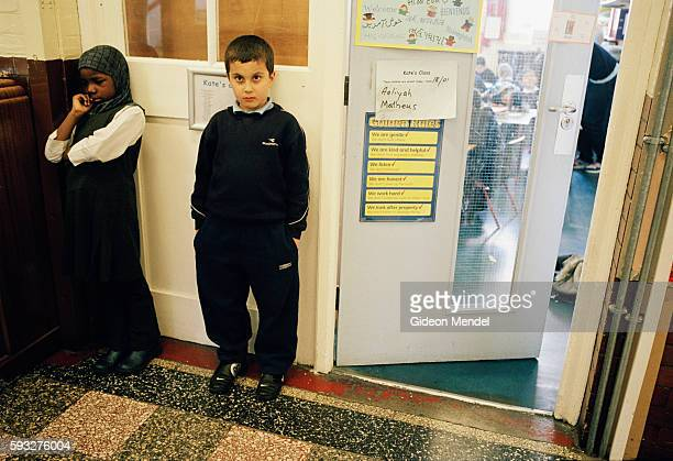 Two Year 3 pupils at Millfields Community School are in trouble and stand outside their classroom because their altecation had just disrupted the...