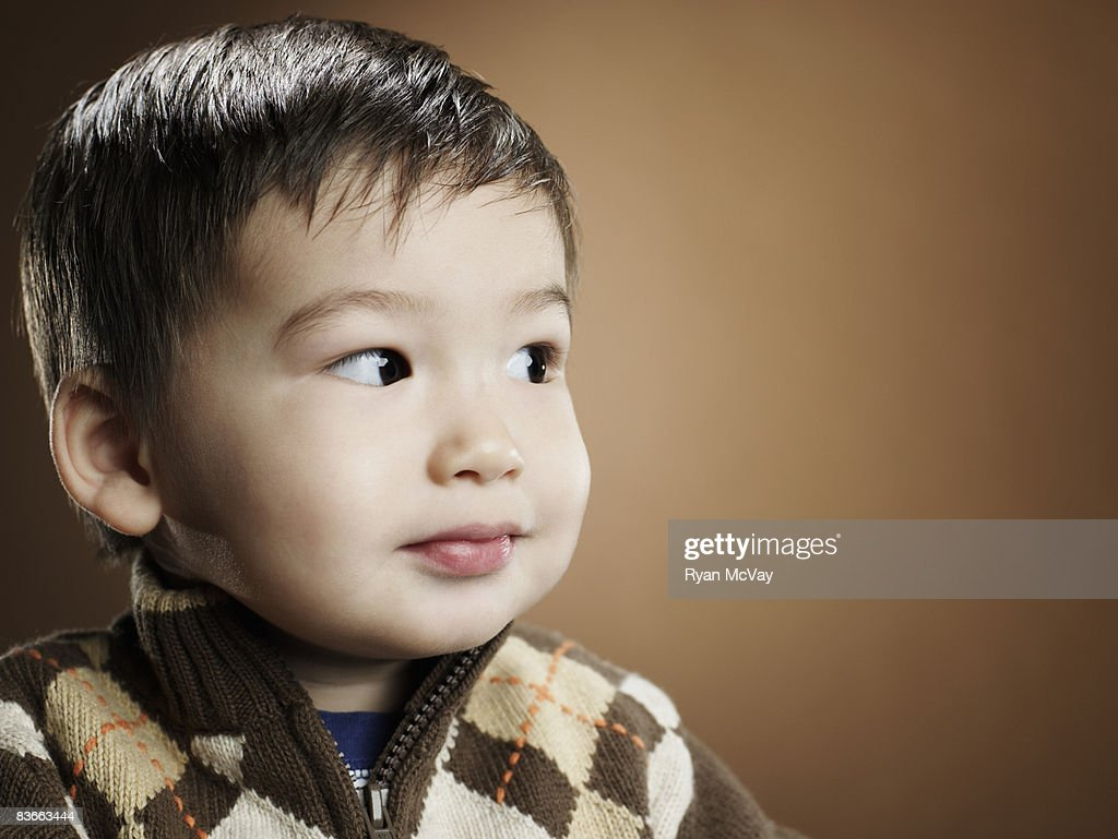 Two year old boy looking serious. : Stock Photo