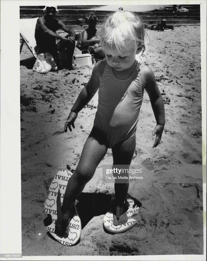 Two Year old Cassie Waters of Dee why with Australian shaped thongs.This object is called an Auzzie Thong, which its manufacturers hope will take Australia's feet by storm.The thong, along with the Esky, teh stump-jump plough and the rotary clothes-hoist, : News Photo