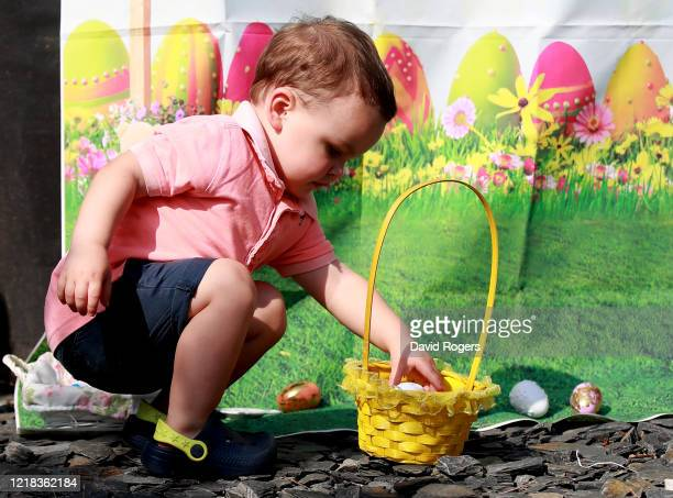 Two year old Donovan Ingham takes part in a Easter egg hunt at his home on April 12 2020 in Northampton United Kingdom Public Easter events have been...