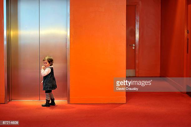 two year old girl standing by lift - crausby stock pictures, royalty-free photos & images