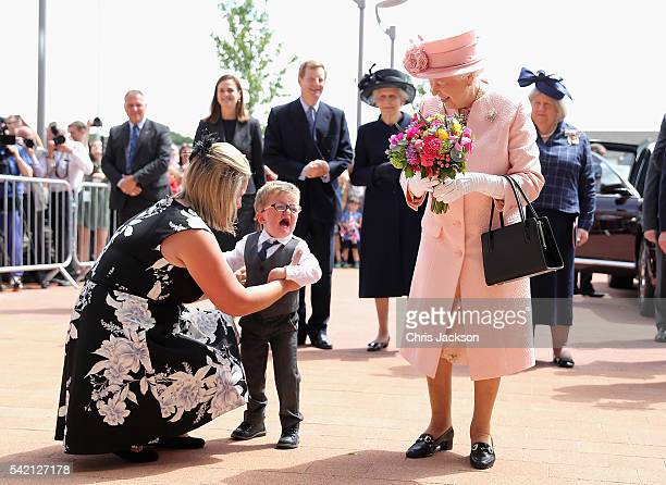 Two year old Lewis Connet bursts into tears as he presents Queen Elizabeth II with flowers as she arrives with the Duke of Edinburgh to officially...