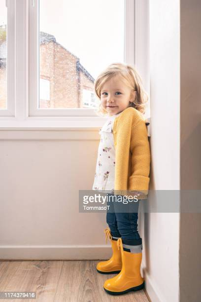 two years old baby at home in a autumn rainy day - 2 3 years stock pictures, royalty-free photos & images