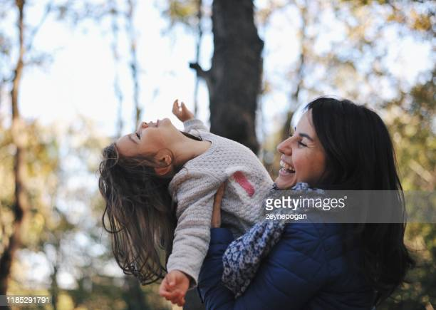 two years old baby spending time with her mom - 2 3 years stock pictures, royalty-free photos & images