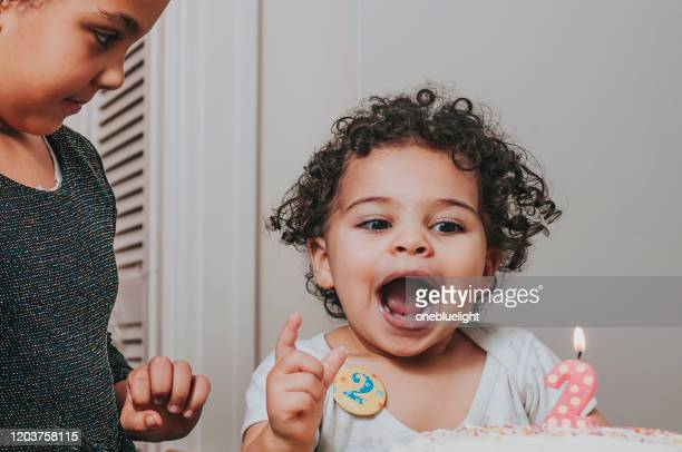 people: two years old birthday girl - onebluelight stock pictures, royalty-free photos & images