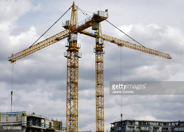BERLIN GERMANY AUGUST Two yellow cranes for house construction are pictured on August 10 2018 in Berlin Germany
