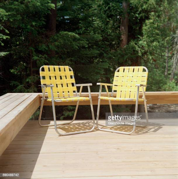 two yellow folding chairs - foldable stock pictures, royalty-free photos & images