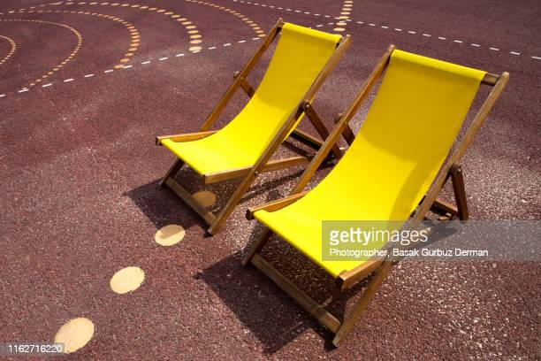 Two yellow lounge chairs