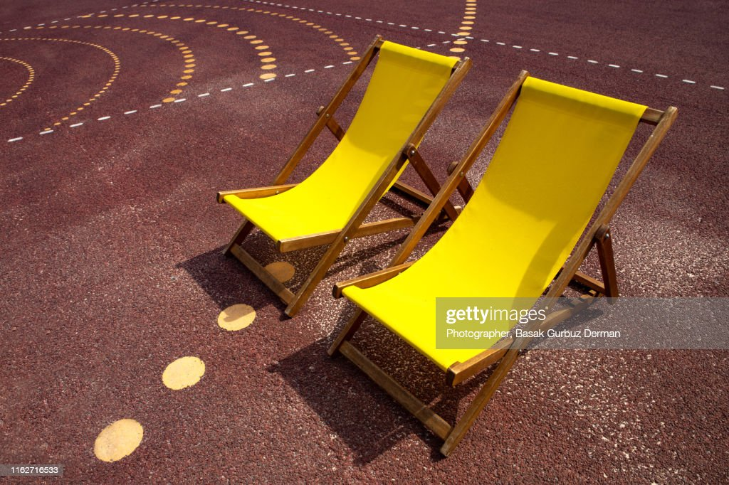 Two yellow lounge chairs : Stock Photo