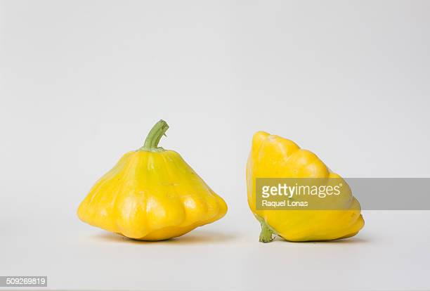 Two yellow pattypan squash