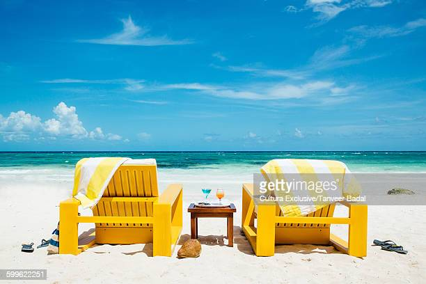 Two yellow sun loungers on hotel beach, Tulum, Riviera Maya, Mexico