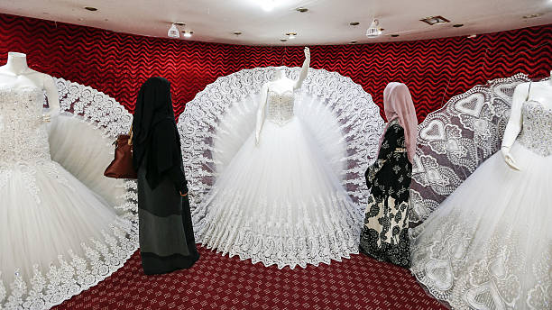 Two Yemeni Women One Clad In A Face Covering Burqa Browse Through Wedding