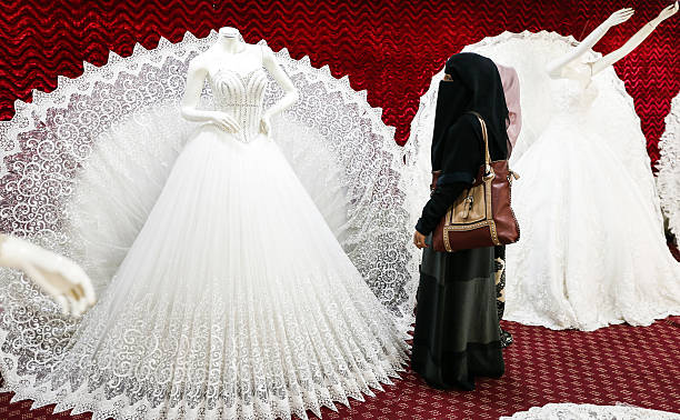 Two Yemeni Women One Clad In A Face Covering Burqa Browse Through Wedding Dresses Shop The Capital Sanaa On January 28 2017 Pictures
