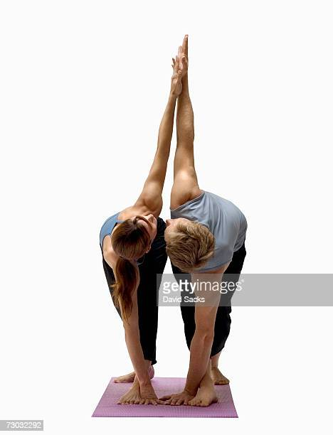 Two yoga students in mirroring pose