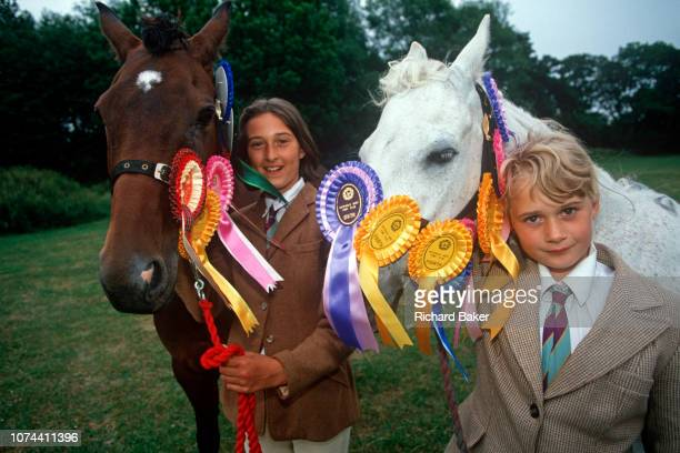 Two young 1990s girls stand with their beloved ponies at a gymkhana in on 17th September 1999 in Cheltenham Gloucestershire England The word gymkhana...