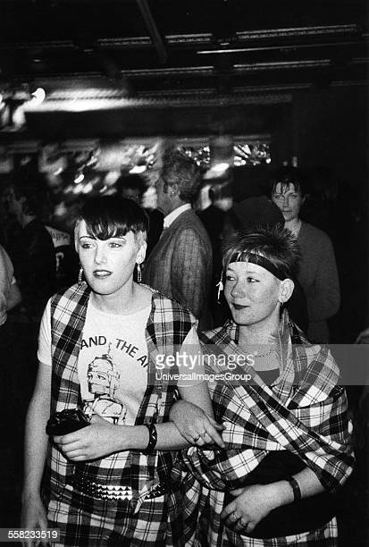 Two young Adam The Ants fans at a gig wearing matching tartan outits London UK 1980's