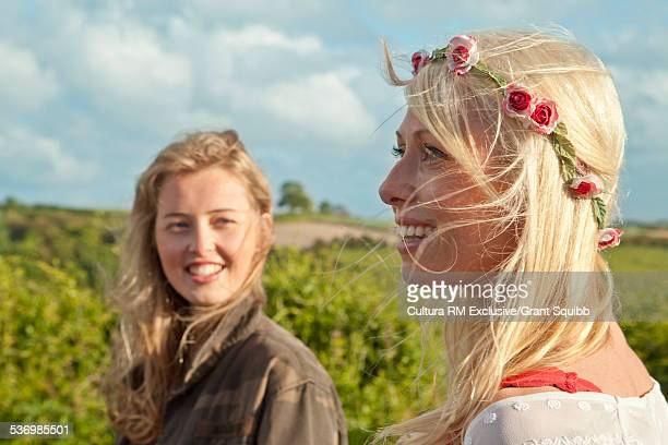 Two young adult female friends in rural field