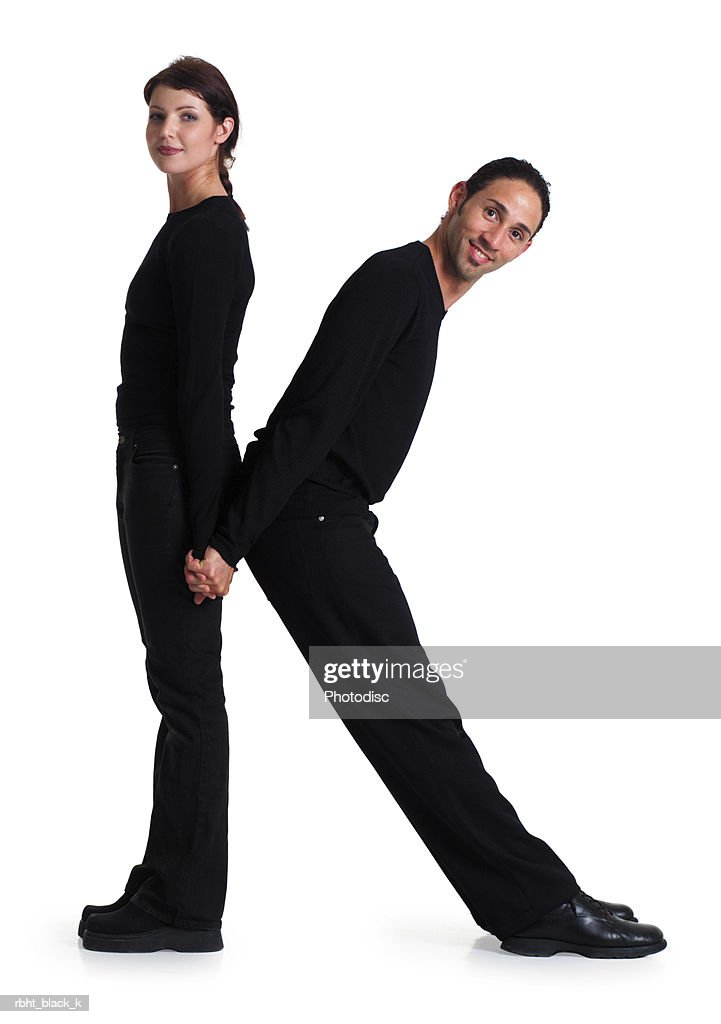 two young adults dressed in black create the letter K : Stockfoto