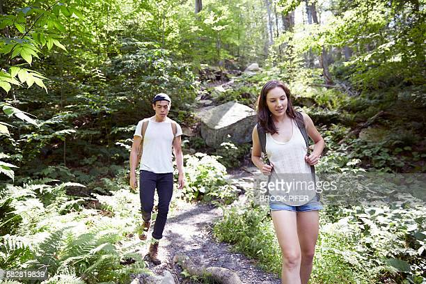 Two young adults exploring nature on hike