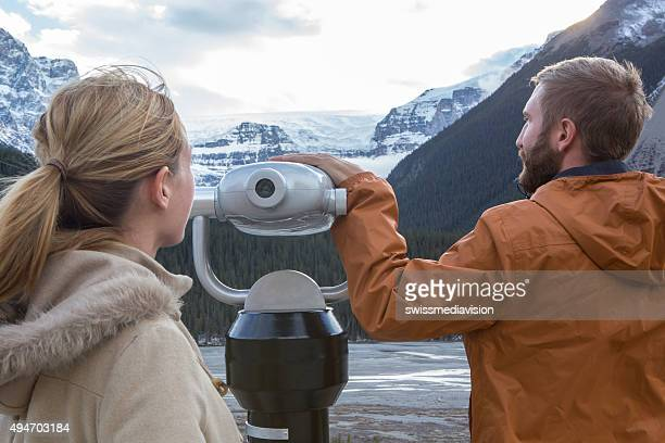 Two young adults looking at the glacier from viewfinder