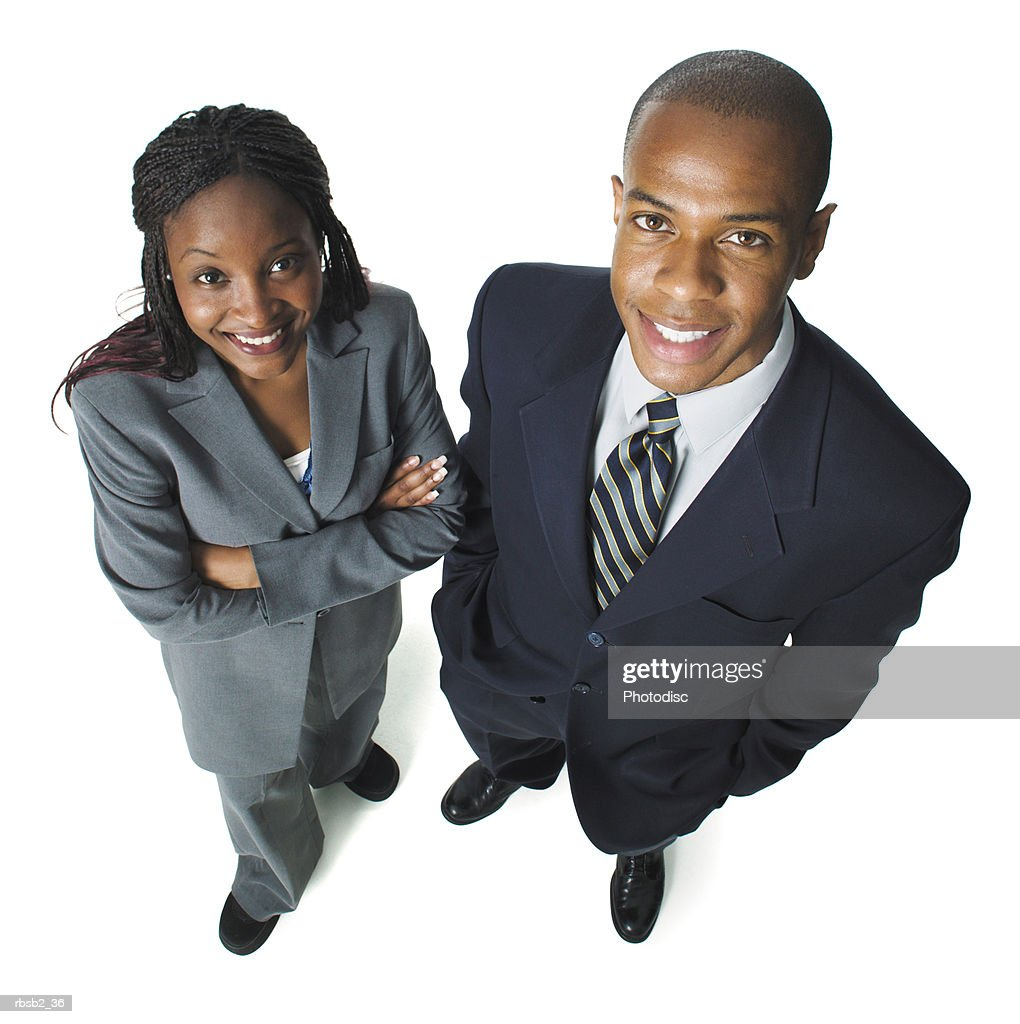 two young african american business people stand side by side smiling up at the camera : Foto de stock