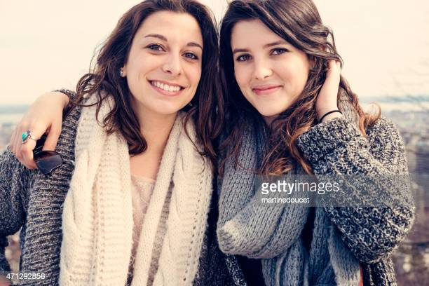 """two young and happy women posing over cityscape. - """"martine doucet"""" or martinedoucet stock pictures, royalty-free photos & images"""