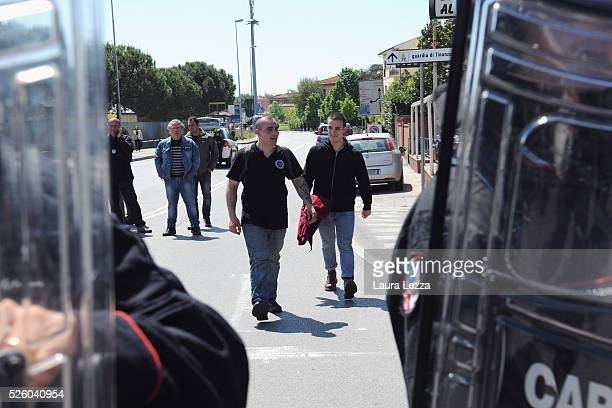 Two young antagonists are released by police after clashes contesting the Italian prime Minister Matteo Renzi after the celebration of the...