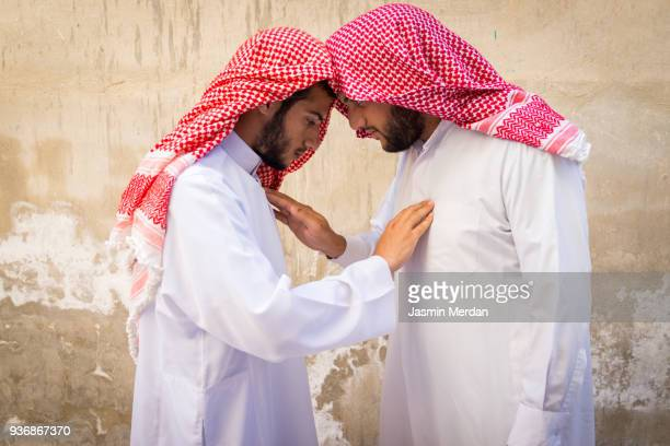 two young arabian man touching each other - homme marocain photos et images de collection