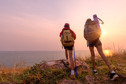 Two young Asian female hipster hiking on mountain holiday, wild adventure. Background for Travel concept - gettyimageskorea