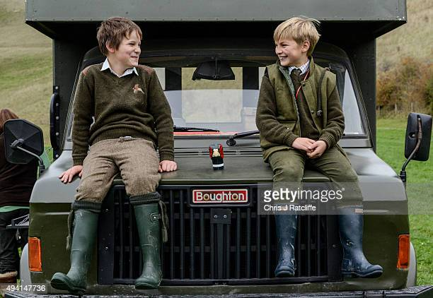 Two young assistants take a break on a pheasant and partridge shoot on October 23 2015 in Oxfordshire England The UK pheasant shooting season begins...