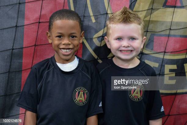 Two young Atlanta United fans laugh prior to the start of the match between Atlanta United and Columbus Crew on August 19th 2018 at MercedesBenz...