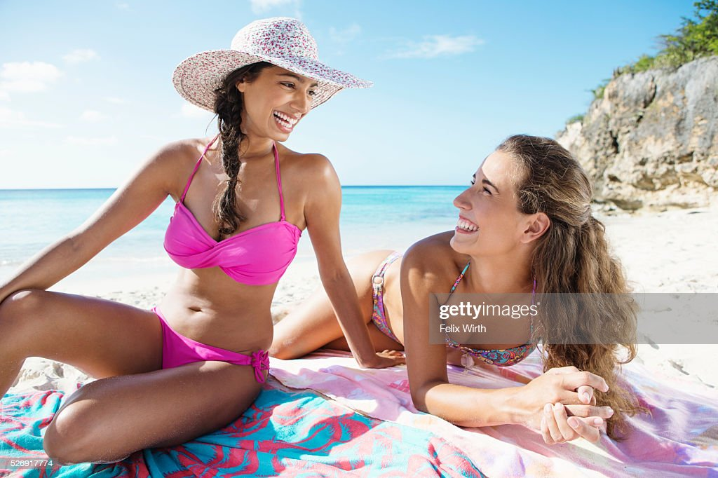 Two young attractive women resting on beach : Foto de stock