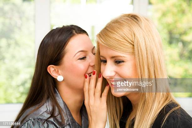 Two young beautiful women chating - gossip