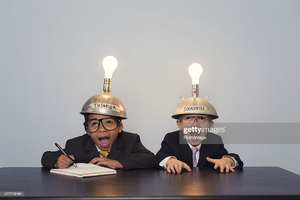 Two Young Boy Dressed in Suits and Thinking Caps : Stock Photo